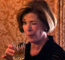 "Lucille from ""Arrested Development"" winking"